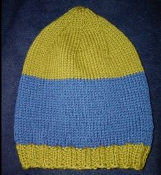 Now here is an easy knitting pattern for an adult hat knit on straight needles. I think I found my next project!