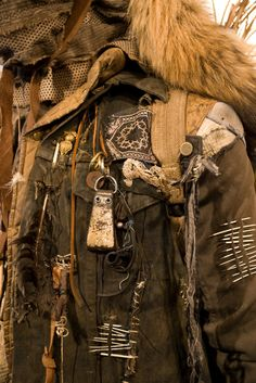 Distressed Jacket. <3    Porcupine quills, fur, feathers, dangles, charms, bits and found objects