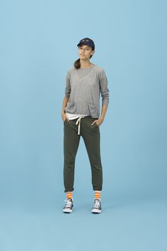 When sportswear takes over style: choose this look that is both comfy and cool. A pair of military-green fleece trousers matched with a lightly-perforated cotton top with buttons on the back #SUN68 #SS16 #woman #top #cotton #trousers #cool #military