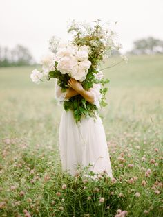 An armful of flowers.