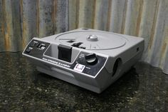 If you don't buy me now someone else will. http://tincanindustries.com/products/kodak-ektagraphic-iii-a-slide-projector-fully-tested-free-shipping-included If it is already sold, keep searching, there is plenty more to find.