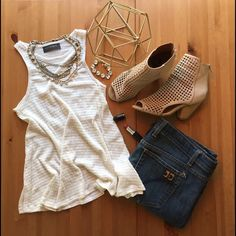 """IVORY SWING TANK This sleeveless top features a rounded neckline and a relaxed fit. Great basic piece for layering.  Country: USA Fabric Content: 49% RAYON 43% POLYESTER 7% FLEX 1% SPANDEX Description: L: 24"""" B: 30"""" W:34"""" (small) ▫️PRICE FIRM UNLESS BUNDLED ▫️NO TRADES ▫️NO PP Tops Tank Tops"""