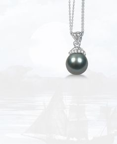 Black   Freshwater Cultured Pearl and Diamond   Pendant 0.04ctw (9mm) - Classic beauty with a hint of shimmer make this 9mm   grey-black Freshwater cultured pearl and diamond pendant a real standout.A   14K white gold setting and matching double chain se