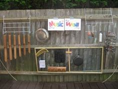 Outdoor music wall on a fence-great for preK & kindergarten playground
