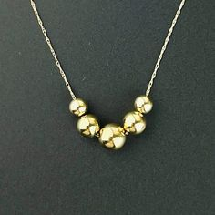 Solid 14K Gold Floating Ball Bead Necklace