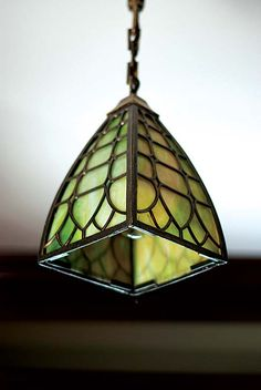 Lighting: Restored vintage pendant crowning entry-room or dining room