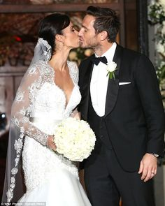 A kiss for the newlyweds: Christine and Frank looked picture-perfect as they departed the ...