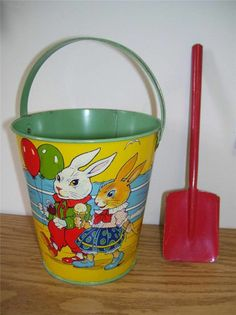 "Vintage Tin Sand Pail with ""Mr and Mrs. Rabbit"" on it. This was sold in the dime store at Easter,with grass in it, topped by candy - later used by the children at the seashore."