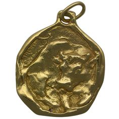 Cartier London Taurus Zodiac Pendant | From a unique collection of vintage more jewelry at http://www.1stdibs.com/jewelry/more-jewelry-watches/more-jewelry/