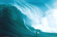 Laird Hamilton riding a giant at Peahi