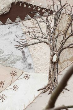I ADORRE the tree and the ivory on ivory fabric behind it!!! tree embroidery
