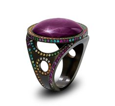 ASTERICAL RING-Solange Azagury-Partridge. A cabochon star Ruby surrounded by Diamonds, pink Sapphires and Rubies in blackened 18ct white gold.