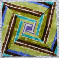 Using striped fabric at an unusual angle makes a great spiral block - this took some serious planning