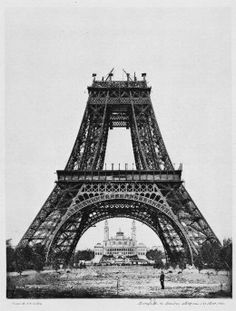 La tour Eiffel, is an iron lattice tower located on the Champ de Mars in Paris. It was named after the engineer Gustave Eiffel, whose company designed and built the tower. Erected in 1889 as the. Vintage Pictures, Old Pictures, Old Photos, Famous Photos, Rare Photos, Paris Torre Eiffel, Photos Rares, Famous Landmarks, Historical Pictures