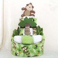 CLOTH Diaper Cake with Prefolds & Handmade Accessories - Ecofriendly Baby Shower Gift  - Custom. $60.00, via Etsy.