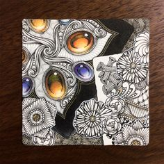 Kae Yoshino, certified zentangle artist and her structured tangled drawings with gems.