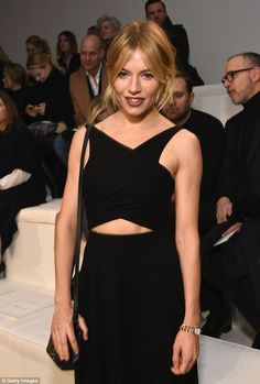 Back to black: Sienna Miller showed her sartorial prowess once again on Thursday, when she...