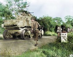 American troops walk with a M5 Stuart tank on their way to the French town of Le Coudray, south west of Paris, 1944.