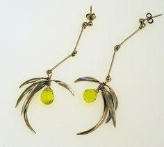 Reflections Earrings Iosif with ruthenium plated Silver 925 & Peridot pear-cut gemstones.  Earrings Code:3381.ER.1821.SP.001