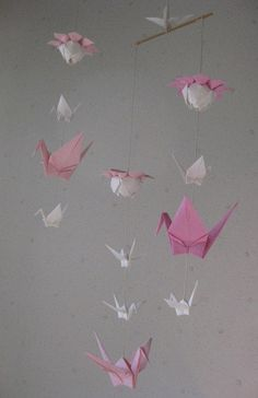 A personal favorite from my Etsy shop https://www.etsy.com/listing/213324083/mix-sized-origami-mobile-10-cranes-and-3