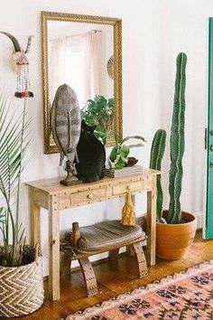 By using clever styling tricks that incorporate storage and ambiance, anyone can have this functional entryway space in their home. Here are 10 solutions to help you fake a foyer like a pro. #hunkerhome #entryway #entrywayideas #entrywaytips #entrywayhack Bohemian Interior Design, Interior Design Living Room, Interior Livingroom, Interior Doors, Creating An Entryway, Green Front Doors, Sweet Home, Boho Chic Living Room, Bohemian Living