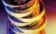 A pile of One pound coins # – Finance tips, saving money, budgeting planner