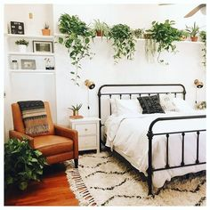 We love the greenery in this bedroom! It adds colour and life to the room.