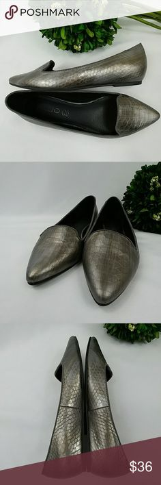 Aldo grey metallic animal print pointed toe flats Aldo genuine leather grey metallic animal print pointed toe flats with sued trim.  In great clean gently used condition.  There is a little flaw you can see in last photo. Not noticable when worn. Aldo Shoes Flats & Loafers