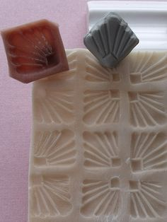 A bead was used to make a mold. The mold was used to make a stamp that was used to make the larger stamp below.