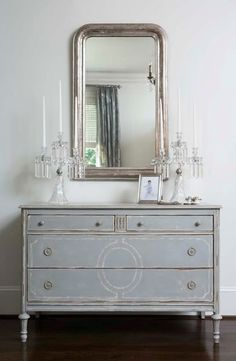 Gray dresser/buffet with painted detail.