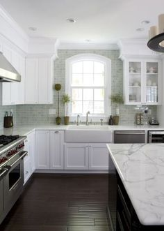 Dark Floors with the White Cabinets, and Farmhouse sink.