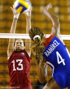 #PuertoRico´s #YarimarRosa, left (13) reacts while tries to block a smash by #Cuba´s  #DaimiRamirez during quarter-final´s game in the #NORCECA #Women´s Continental #Championship in Santo Domingo, Dominican Republic. (AP Photo/Miguel Gomez)