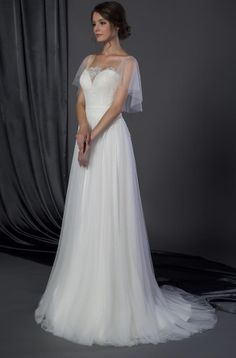 Bridal dress with flutter sleeve cover up.  Sweetheart cut wedding gown with flowing chiffon skirt.  A sheer modesty cover up on a bridal gown made for a church ceremony. Get pricing on custom wedding dresses at www.dariuscordell.com