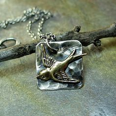 Soaring Free - bird pendant in sterling silver and brass    ...from Lavender Cottage Jewelry