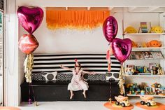 """Bougainvillea and marigold """"LOVE"""" themed birthday party"""