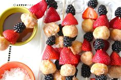 DONUT HOLE BREAKFAST SKEWERS--DONUT HOLES, YOUR FAV FRUIT AND DIPPING SAUCE:) GUESTS WOULD LOVE THIS OR IMAGINE YOUR KIDS BOUNCING DOWN THE STAIRS TO THIS BREAKFAST!!!!! WOOHOO:)