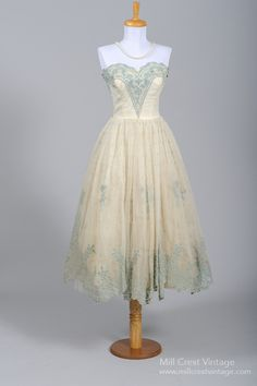 Designed in the 50's, by Cotillion, this unique vintage wedding dress is done in a off white poly chiffon with Wedgewood blue and silver lace appliqu_s over ...