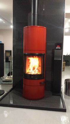 Scan 83 in glossy red shown at our dealers Central Stoves www.
