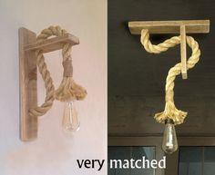 Una combinación que viene de los viejos tiempos. Fin de lámparas de pared de madera reciclada con cuerda. Este matrimonio de materiales crea en el espacio dulce nostálgica y cálida atmósfera. Es para la instalación de una fuente de energía que existe en la pared, pero si te deseo que
