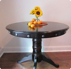 "Give a round dining table industrial ""edge"" with extra large nailheads!"