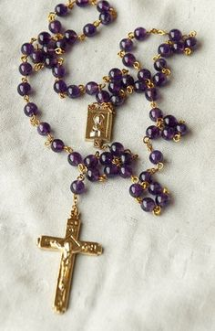 Beautiful Amethyst Rosary Beads.... I still practice the Rosary...its one of my most favorite things to do.