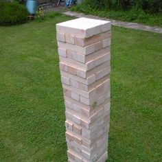 "Make your own giant Jenga-style wooden block stacking game tower.  Then take a page from our friends at CarolynSmithDesigns.com and personalize the blocks with memories or quotes like the ""Guestbook Stones."" Great for grad parties, going away parties, birthday parties and more."