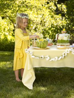 Yellow Gingham and daisies  picnic reception....love the head piece...would be great for the girls.