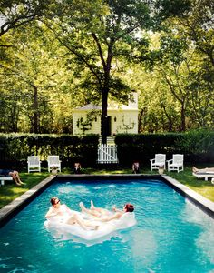 Pool party with white lounge furniture