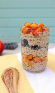 Vegan, No-Cook Berry Peachy Overnight Oats layered with fresh blueberries and peaches - with added superfood chia seeds for an extra boost - A healthy on-the-go breakfast! - From The Glowing Fridge
