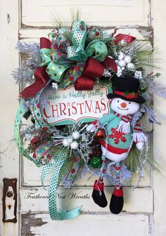 Snowman Wreath is Created on a Pine Base. I have Layered it with a Mixture of Long Needle Pine, Winter Pines, White Berries, and a Sweet Snowman Holding a Vintage Style Tinsel. Christmas Door Wreaths, Christmas Signs, Christmas Holidays, Christmas Crafts, Christmas Decorations, Christmas Reef, Christmas Centerpieces, Father Christmas, Christmas 2017