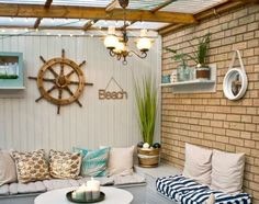 Nautical Beach Patio: http://www.completely-coastal.com/2016/06/nautical-beach-patio-makeover-before-after.html Patio Makeover with Before and After Pictures.