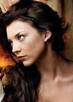 Natalie Dormer as Anne Boleyn in The Tudors. I think she might be a little stuck up...but I like her as an actress