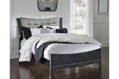 The epitome of fashion-forward design, Amrothi upholstered bed is befitting of a master boudoir. You'll be hard-pressed to choose your favorite dazzling detail. Is it the shiny silver-tone accents or the pearlized finish? Or maybe it's the faux crystals on the tufted headboard. No matter what you love best, Amrothi has style galore. Mattress and foundation/box spring sold separately.