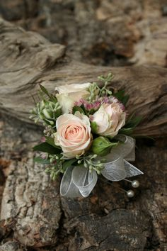 Soft pink corsage.